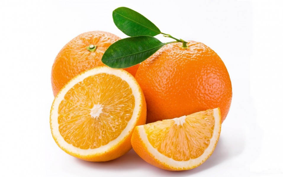group of oranges and orange slices